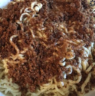 German spätzle noodles with toasted breadcrumbs and crisp bacon crumble