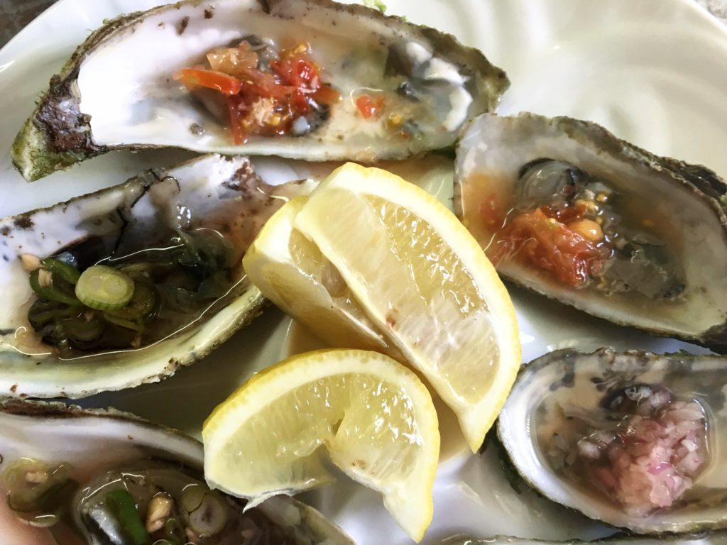 oysters with garnishes