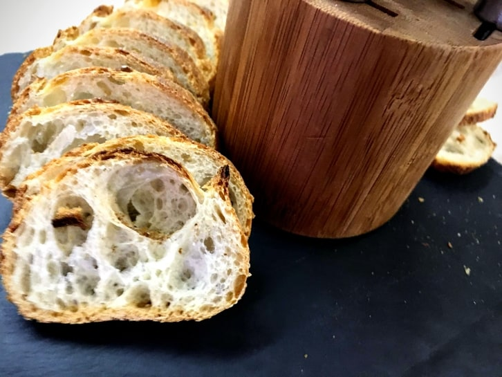 sliced baguette rounds on a cheese board