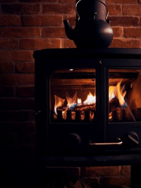 cozy old fashioned wood stove fire
